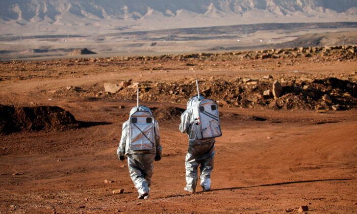 Scientists participate in a demonstration of an experiment led by Austrian and Israeli agencies simulating a mission to Mars, near Mitzpe Ramon, Israel, on Oct. 10, 2021. (Amir Cohen/Reuters)