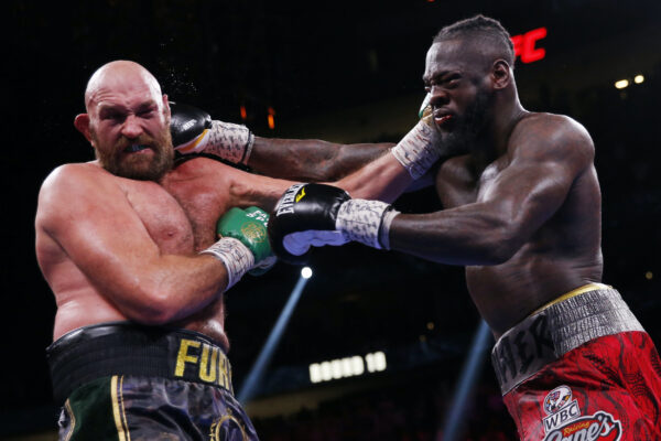 Deontay Wilder, right, and Tyson Fury