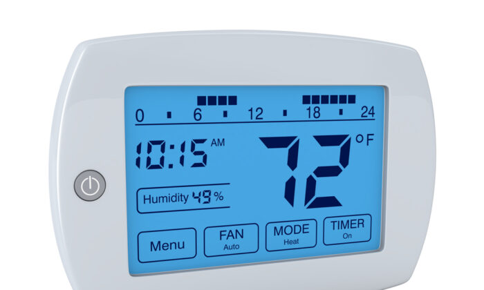 A programmable thermostat will automatically adjust your AC and/or heat use, so that you aren't wasting expensive electricity. (lucadp/Shutterstock)