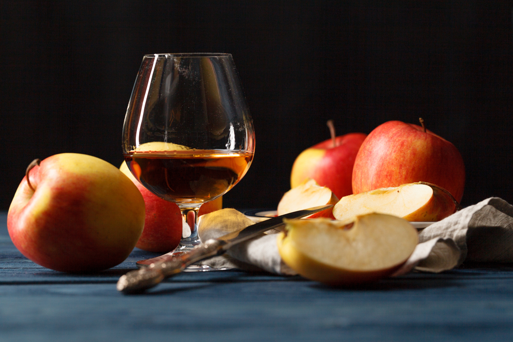 Glasse,Of,Calvados,Brandy,And,Red,Apples