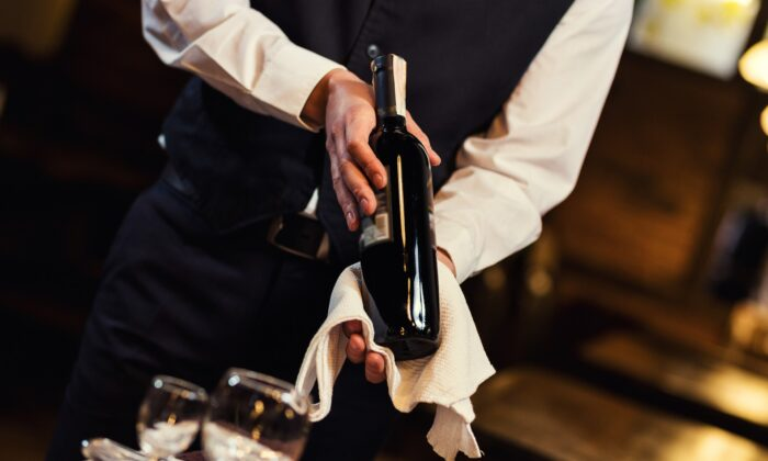 When you're unable to decipher the wine list at a restaurant, ask for assistance. (BONDART PHOTOGRAPHY/shutterstock)