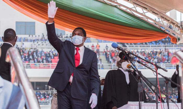 Zambia President Hakainde Hichilema waves at the crowd after taking oath of office at the Heroes Stadium in Lusaka on August 24, 2021. (Salim Dawood/AFP via Getty Images)