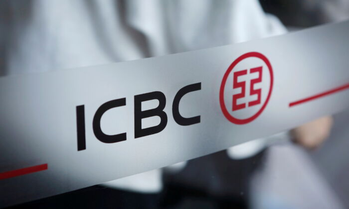 The logo of Industrial and Commercial Bank of China at the entrance to its branch in Beijing on April 1, 2019. (Florence Lo/Reuters)