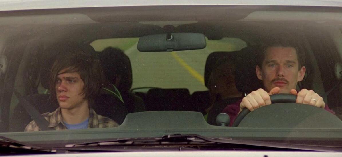 man and boy driving in car in Boyhood