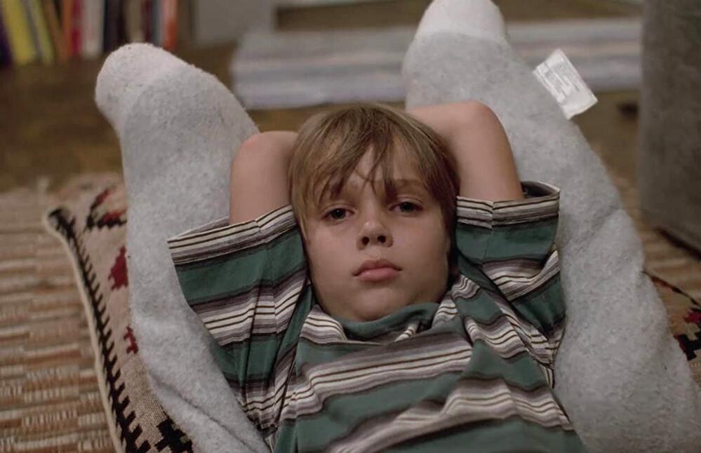 boy lying on pillow in Boyhood