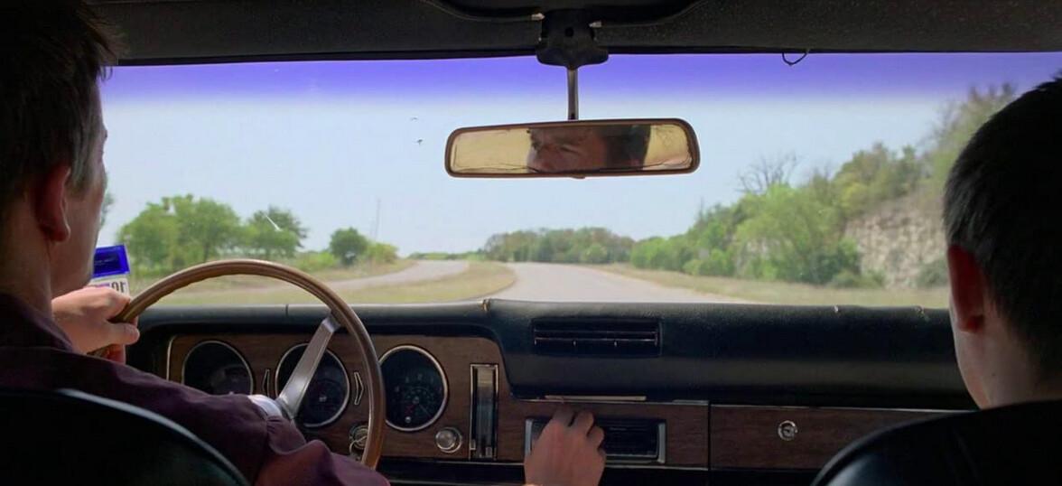 man and boy in car in Boyhood