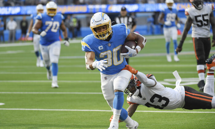 Los Angeles Chargers running back Austin Ekeler scores a touchdown past Cleveland Browns free safety John Johnson (43) during the second half of an NFL football game in Inglewood, Calif., on Oct. 10, 2021. (AP Photo/Kevork Djansezian)