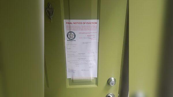 Eviction notice on Carlos Lomena's door