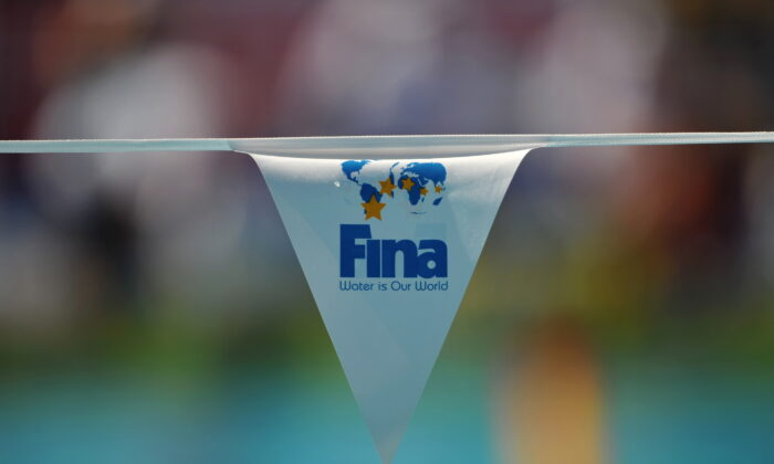The logo of the Swimming governing body FINA is displayed on a flag at the main swimming pool at the 13th FINA World Swimming Championships in Rome on July 26, 2009.  (Photo credit should read MARTIN BUREAU/AFP via Getty Images)