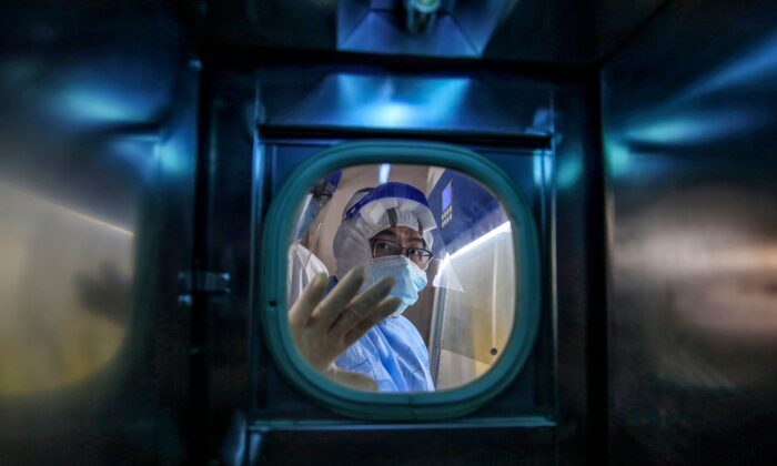 A medical staff member gestures inside an isolation ward at Red Cross Hospital in Wuhan in China's central Hubei Province on March 10, 2020. (STR/AFP via Getty Images)