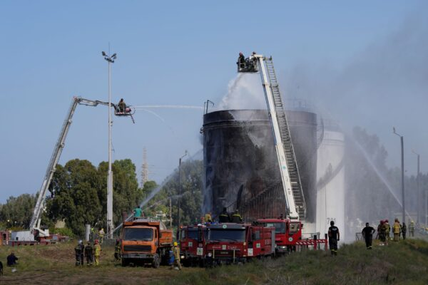 Firefighters work to extinguish a fire