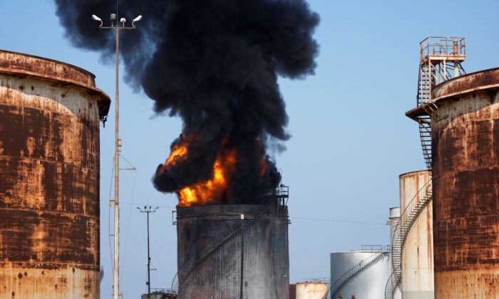 Firefighters work to extinguish a fire in an oil facility in the southern town of Zahrani, south of the port city of Sidon, Lebanon, on Oct. 11, 2021. (Hassan Ammar/AP Photo)