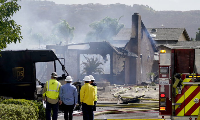 Fire and safety crews work the scene of a plane crash in Santee, Calif., on Oct. 11, 2021. (Gregory Bull/AP Photo)