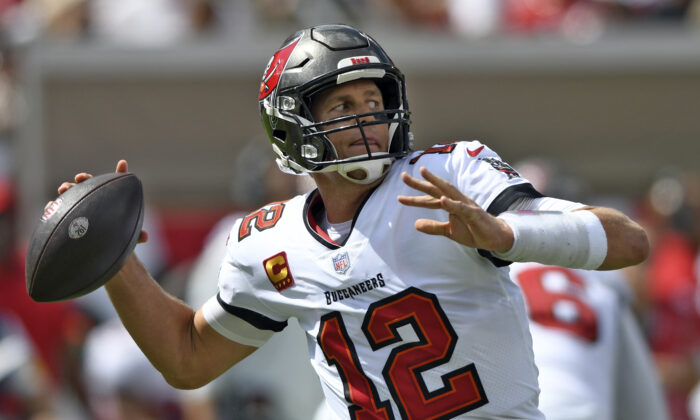 Tampa Bay Buccaneers quarterback Tom Brady (12) throws a pass against the Miami Dolphins during the first half of an NFL football game in Tampa, Fla., on Oct. 10, 2021. (Jason Behnken/AP Photo)