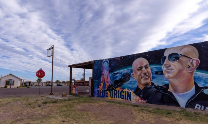 A mural of billionaire Jeff Bezos and his space company Blue Origin a day before his company will send