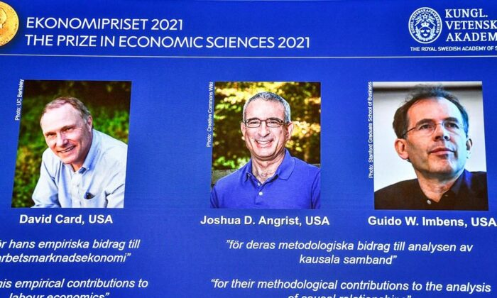 From left, on the screen are the winners of the 2021 Nobel prize for economics; David Card of the University of California at Berkeley; Joshua Angrist from the Massachusetts Institute of Technology; and Guido Imbens from Stanford University, announced during a press conference at the Royal Swedish Academy of Sciences, in Stockholm, Sweden, on Oct. 11, 2021. (Claudio Bresciani/TT via AP)