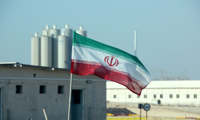 An Iranian flag in Iran's Bushehr nuclear power plant, during an official ceremony to kick-start works on a second reactor at the facility on Nov. 10, 2019.  (Atta Kenare/AFP via Getty Images)
