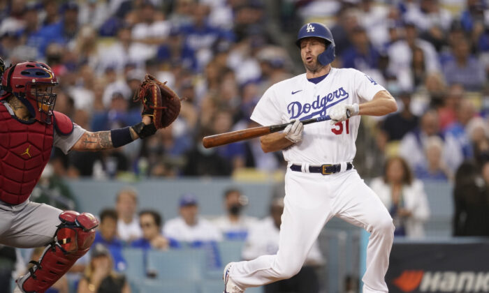 Los Angeles Dodgers' Max Scherzer reacts to a close pitch as he attempted to bunt during the third inning of a National League Wild Card playoff baseball game against the St. Louis Cardinals in Los Angeles on Oct. 6, 2021. (AP Photo/Marcio Jose Sanchez)
