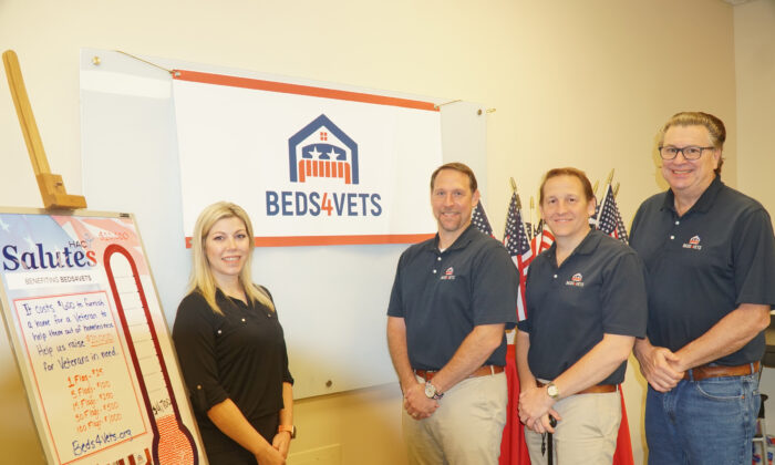 From left: Lisa McGuire from the Hockessin Athletic Club with Christopher Cascio, Zachary Bagdon, and Rick Martin from Beds4Vets. (Lily Sun/The Epoch Times)