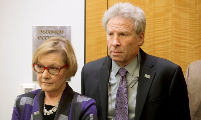 Andy Parker and his wife, Barbara, listen as Virginia Gov. Terry McAulliffe announces a compromise on a set of gun bills at the Capitol in Richmond, Va., on Jan. 29, 2016. (Steve Helber/AP Photo)