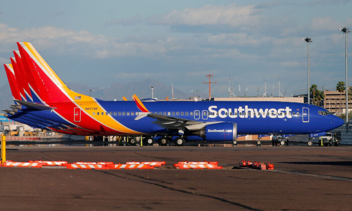 In this file photo a group of Southwest Airlines aircraft sit on the tarmac at Phoenix Sky Harbor International Airport in Phoenix. Over the Columbus Day weekend, Southwest has canceled thousands of flights, reportedly because staff are protesting the company's vaccine mandate. (Ralph Freso/Getty Images)