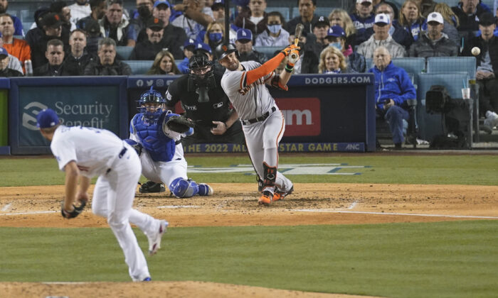 San Francisco Giants' Evan Longoria hits a solo home run off of Los Angeles Dodgers starting pitcher Max Scherzer, left, as catcher Will Smith looks on during the fifth inning of Game 3 of a baseball National League Division Series in Los Angeles on Oct. 11, 2021. (AP Photo/Marcio Sanchez)