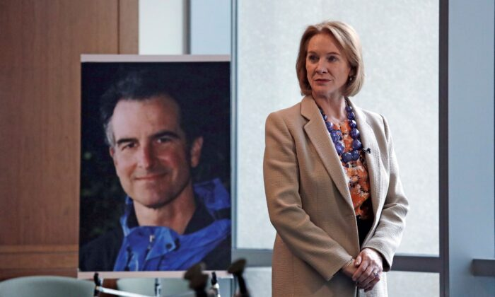 Seattle Mayor Jenny Durkan, former U.S. Attorney for the Western District of Washington, stands near a photo of slain Assistant United States Attorney Thomas Wales in Seattle on Feb. 21, 2018. (Elaine Thompson/AP Photo)