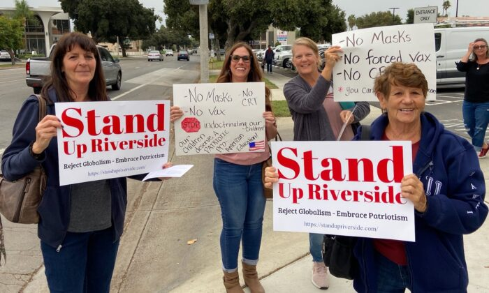 Parents and teachers hold signs in protest at Riverside Unified School District in Riverside, Calif., on Oct. 7, 2021. (Courtesy of Heather Knapp)