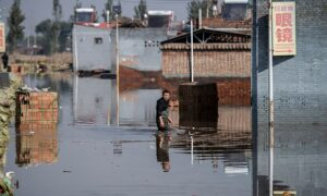 Man-Made Disaster: Flood Victims Fend for Themselves