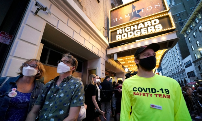 """People wait to attend the Broadway musical """"Hamilton"""" after showing their vaccination cards at the Richard Rodgers Theatre in New York on Sept. 14, 2021. (TIMOTHY A. CLARY/AFP via Getty Images)"""