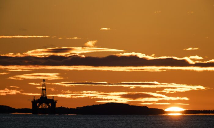 The sun rises behind a redundant oil platform moored in the Firth of Forth near Kirkcaldy, Fife, UK, in an undated file photo. (Jane Barlow/PA)