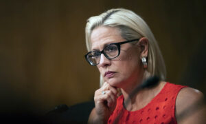 Sen. Kyrsten Sinema Confronted by Climate Change Advocate at Airport
