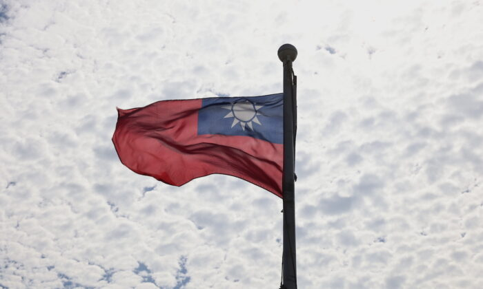 A Taiwanese flag flaps in the wind in Taoyuan, Taiwan, on June 30, 2021. (Ann Wang/Reuters)