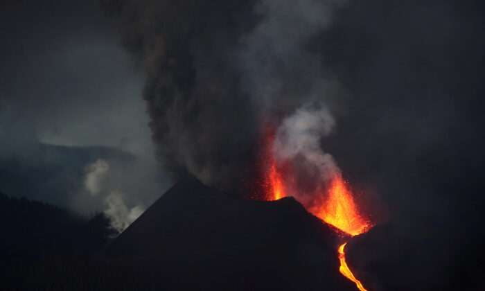 Cumbre Vieja volcano spews lava and smoke as it continues to erupt on the Canary Island of La Palma, as seen from Tacande, Spain, on Oct. 12, 2021. (Sergio Perez/Reuters)