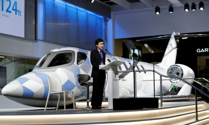 Michimasa Fujino, president and CEO of Honda Aircraft Company, unveils the HondaJet 2600 concept plane at the Las Vegas Convention Center during the NBAA Business Aviation Convention Exhibition in Las Vegas, Nevada, on Oct. 12, 2021. (Steve Marcus/Reuters)