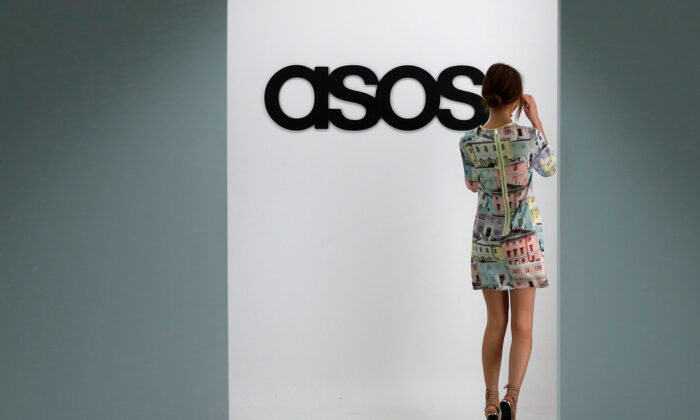 A model walks on an in-house catwalk at the headquarters of British online fashion retailer ASOS in London, Britain, on April 1, 2014. (Suzanne Plunkett/Reuters)
