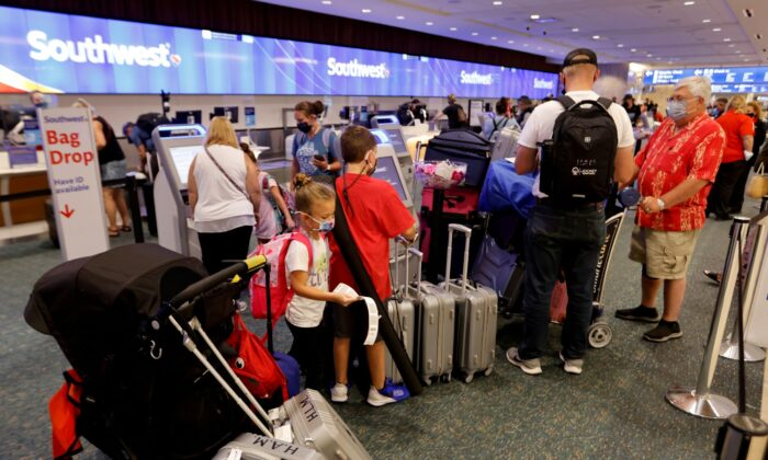 Passengers check in for a Southwest Airlines flight at Orlando International Airport in Orlando, Fla., on Oct. 11, 2021. (Joe Skipper/Reuters)