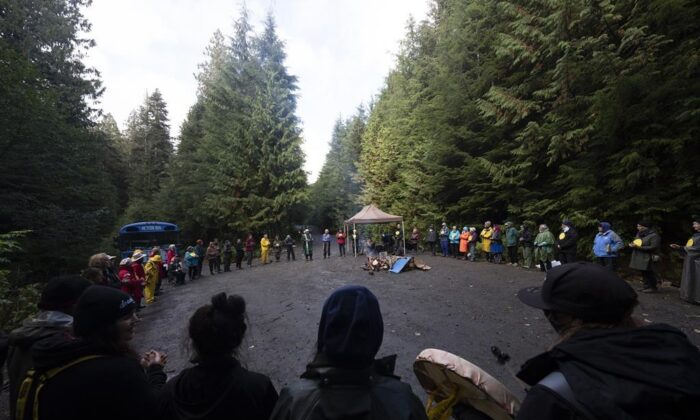 """Elders for Ancient Forests along with people declaring themselves """"land defenders"""" take part in a peace circle along a logging road in the Fairy Creek logging area near Port Renfrew, B.C., Oct. 5, 2021. (The Canadian Press/Jonathan Hayward )"""