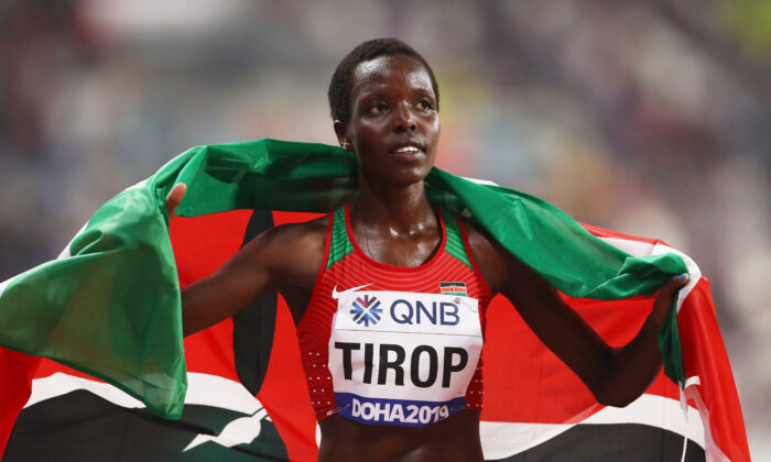 Agnes Jebet Tirop of Kenya celebrates winning bronze in the Women's 10,000-meter final during day two of 17th IAAF World Athletics Championships Doha 2019 at Khalifa International Stadium in Doha, Qatar, on Sept. 28, 2019. (Alexander Hassenstein/Getty Images for IAAF)
