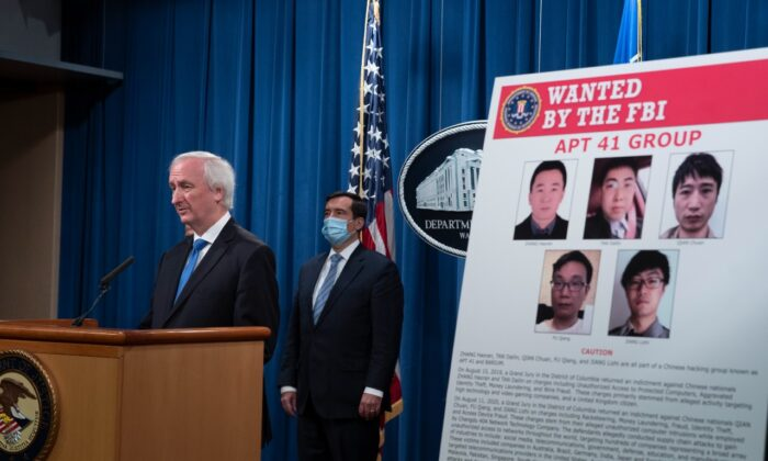 Deputy Attorney General Jeffery Rosen speaks to the media about charges and arrests related to a computer intrusion campaign tied to the Chinese regime by a group called APT 41 at the Department of Justice in Washington, on Sept. 16, 2020. (Tasos Katopodis-Pool/Getty Images)