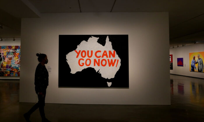 A person takes in the work of artist Richard Bell at the MCA (Museum of Contemporary Art Australia) in Sydney, Australia, on Oct. 12, 2021. (Lisa Maree Williams/Getty Images)