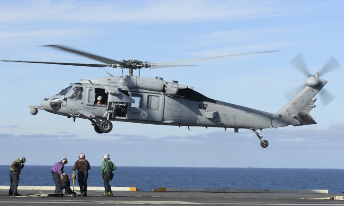 An MH-60S Sea Hawk helicopter prepares to land on the flight deck of the aircraft carrier USS Nimitz in the Pacific Ocean, on March 19, 2017. (Mass Communication Specialist Seaman Ian Kinkead/U.S. Navy via AP)