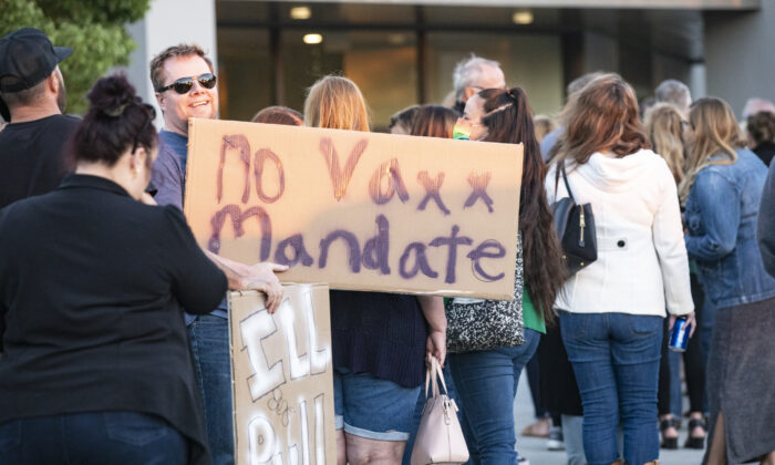 Parents gather to express their concerns over vaccine mandates for students at the Placentia Yorba Linda Unified School District building in Placentia, Calif., on Oct. 12, 2021. (John Fredricks/The Epoch Times)