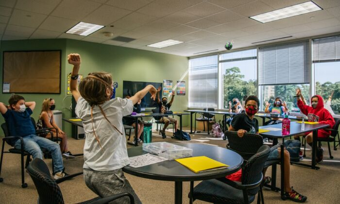 Children are seen wearing masks in compliance with a mask mandate in an activity in class at the Xavier Academy in Houston, Texas, on Aug. 23, 2021. (Brandon Bell/Getty Images)