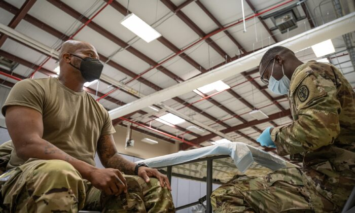 A U.S. service member prepared to get a COVID-19 vaccine at Fort Knox, Ky., on Sept. 9, 2021. (Jon Cherry/Getty Images)
