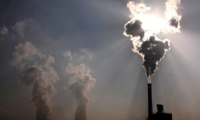 A coal-burning power plant can be seen in the city of Baotou, in China's Inner Mongolia, on Oct. 31, 2010. (David Gray/Reuters)