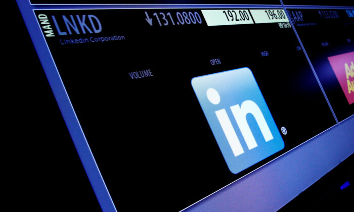 The ticker symbol and trading information for LinkedIn Corp. is displayed on a screen  at the post where it's traded, before the start of trading, on the floor of the New York Stock Exchange (NYSE) in New York on June 13, 2016. (Brendan McDermid/Reuters)