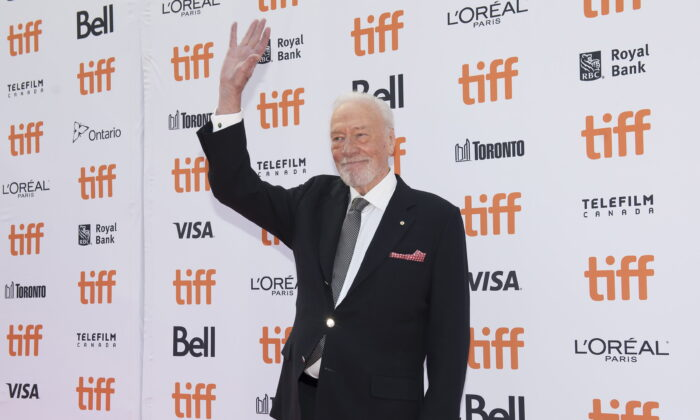 """Actor Christopher Plummer poses for photographs on the red carpet for the new movie """"Knives Out"""" at the Toronto International Film Festival in Toronto on Sept. 7, 2019. (The Canadian Press/Nathan Denette)"""