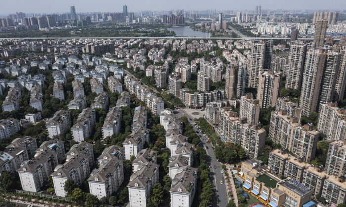 An aerial view shows the Evergrande Changqing community in Wuhan, Hubei Province, China, on Sept. 26, 2021. In 2015, Evergrande real estate acquired four super large projects in Haikou, Wuhan, and Huizhou, with a total construction area of nearly 4 million square meters and a total amount of 13.5 billion yuan. Evergrande, China's largest property developer, is facing a liquidity crisis with total debts of around $300 billion. The problems faced by the company could impact China's economy, and the global economy at large. (Getty Images)