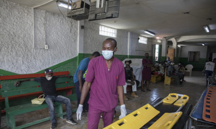 A medical worker is seen at the Martissant Hospital, in Martissant, Haiti, on May 31, 2021. (Photo by Valerie Baeriswyl/AFP via Getty Images)